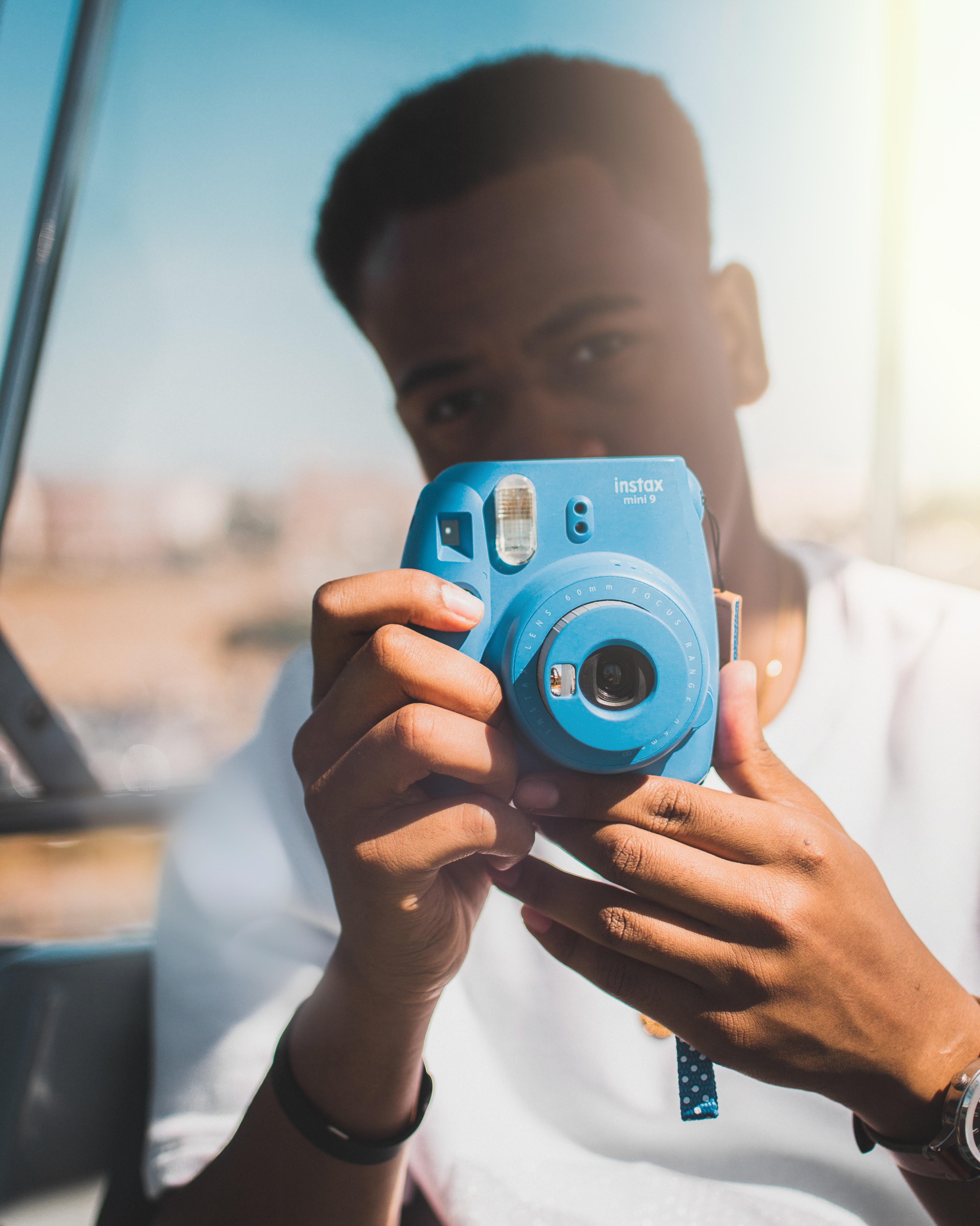 person using Fujifilm Instax Mini 9