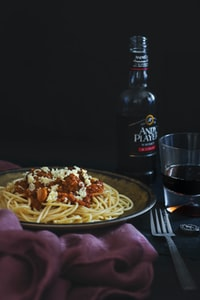 spaghetti beside fork and Andy bottle