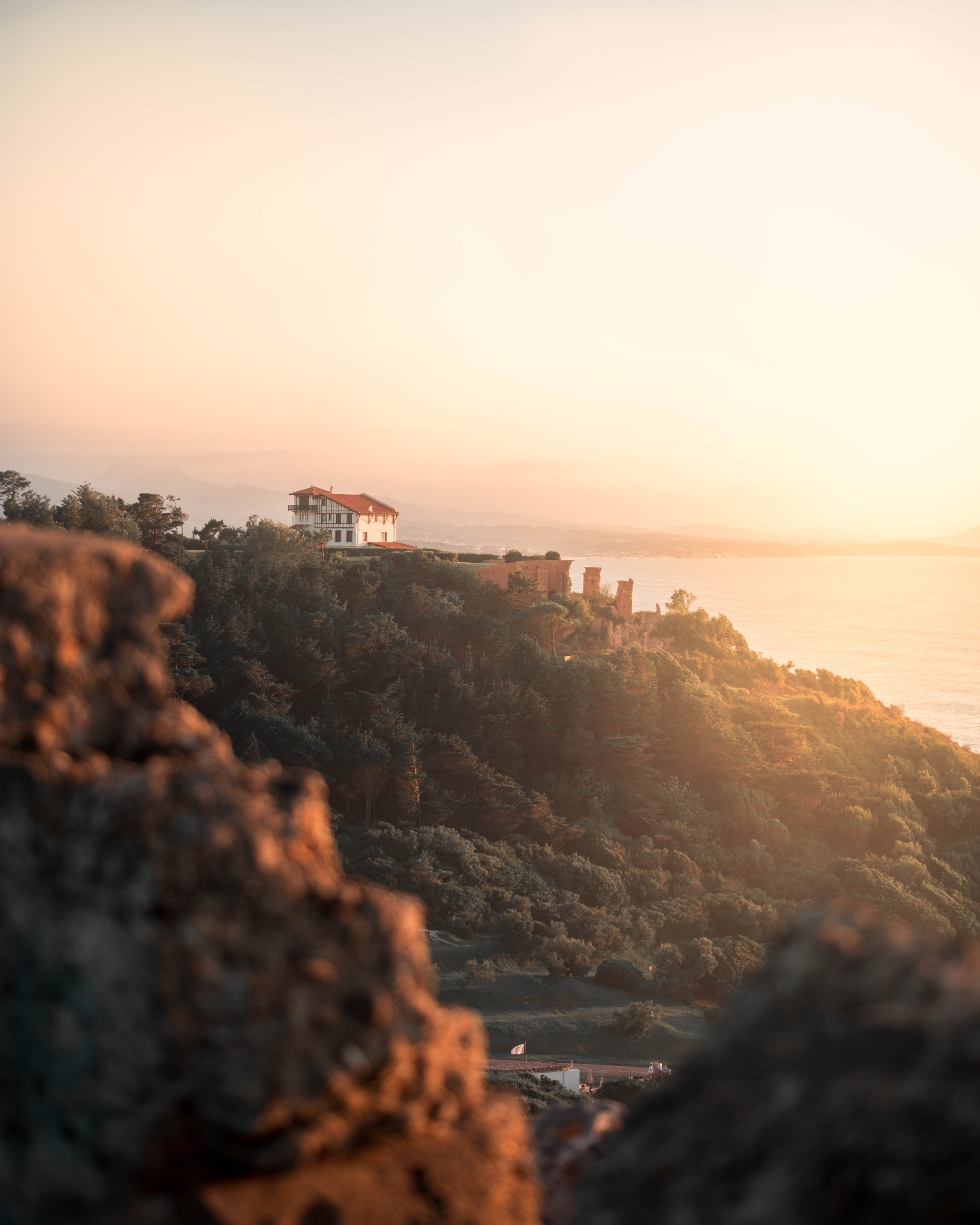 concrete castle on hill beside body of water