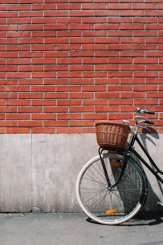 female beach cruiser bike on wall