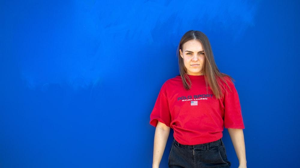 woman standing near blue wall