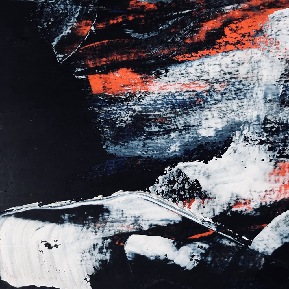 white, black, and orange abstract painting