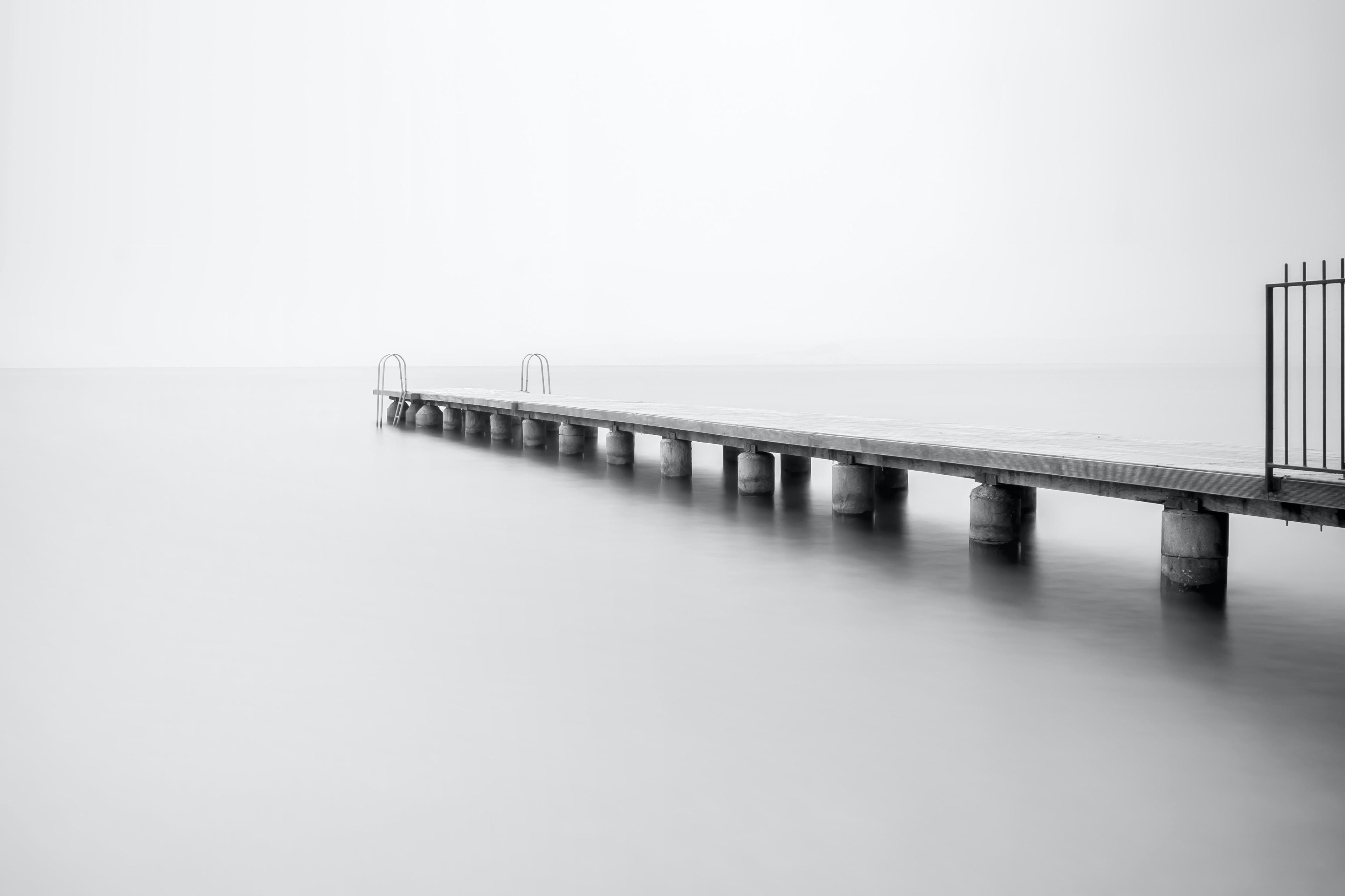 grayscale photo of concrete dock