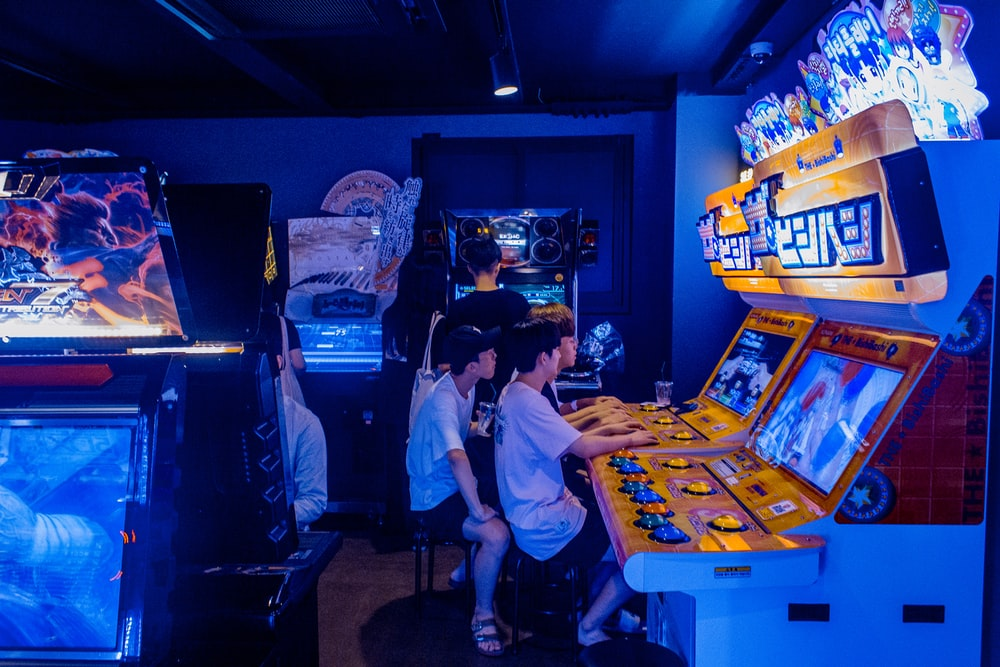 People Playing Arcade Games Photo Free People Image On