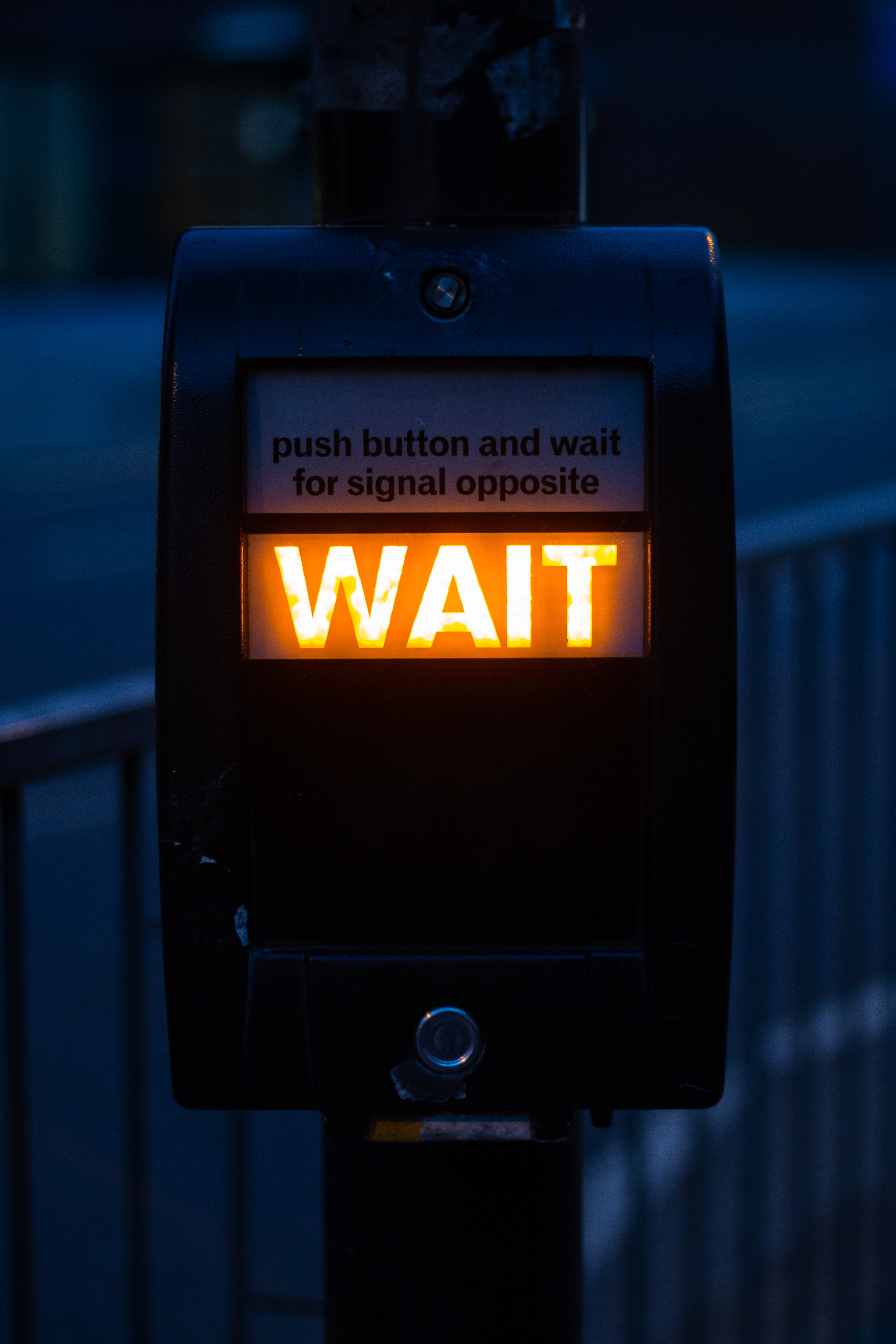 turned on black road signage displaying wait
