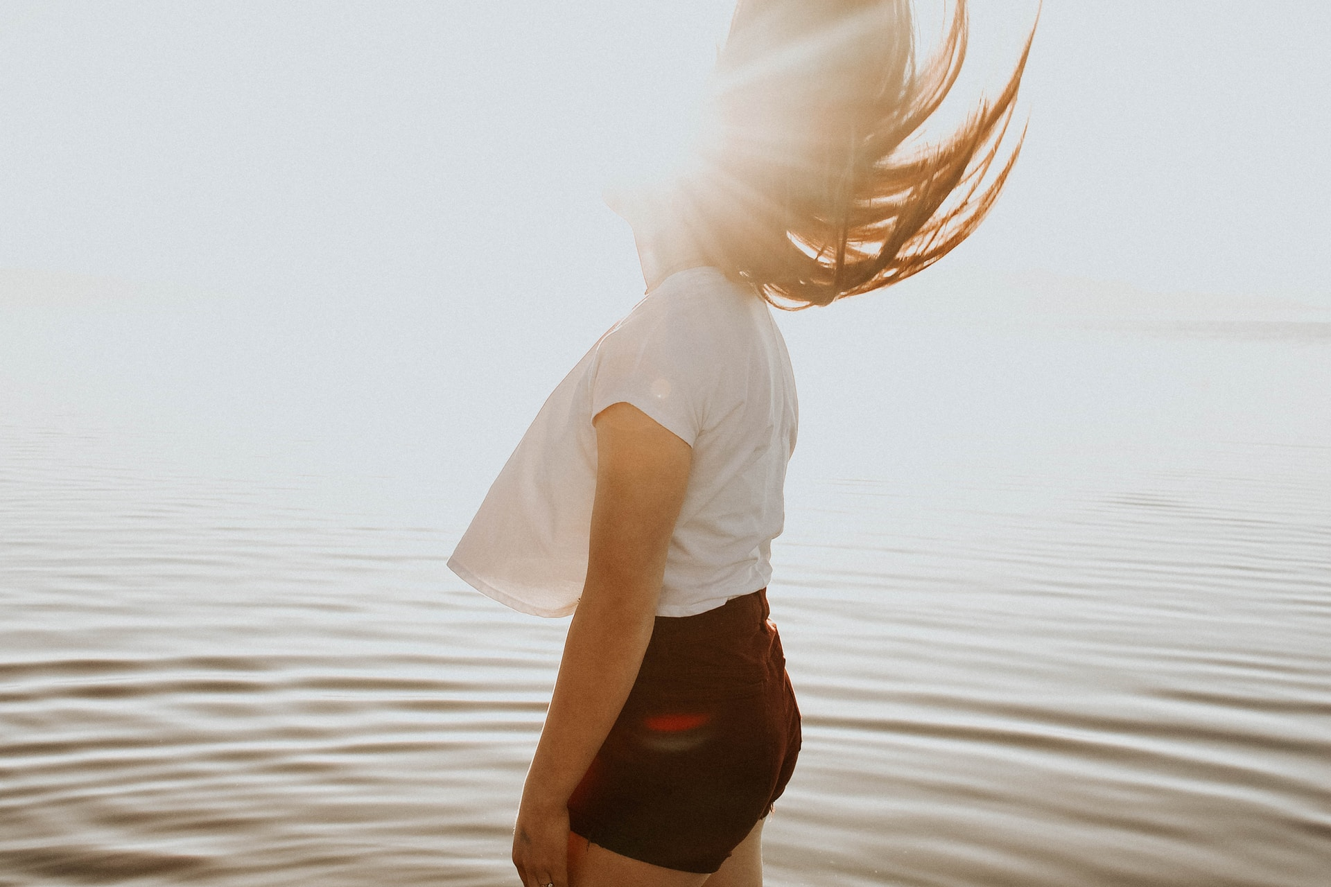 woman standing in body of water