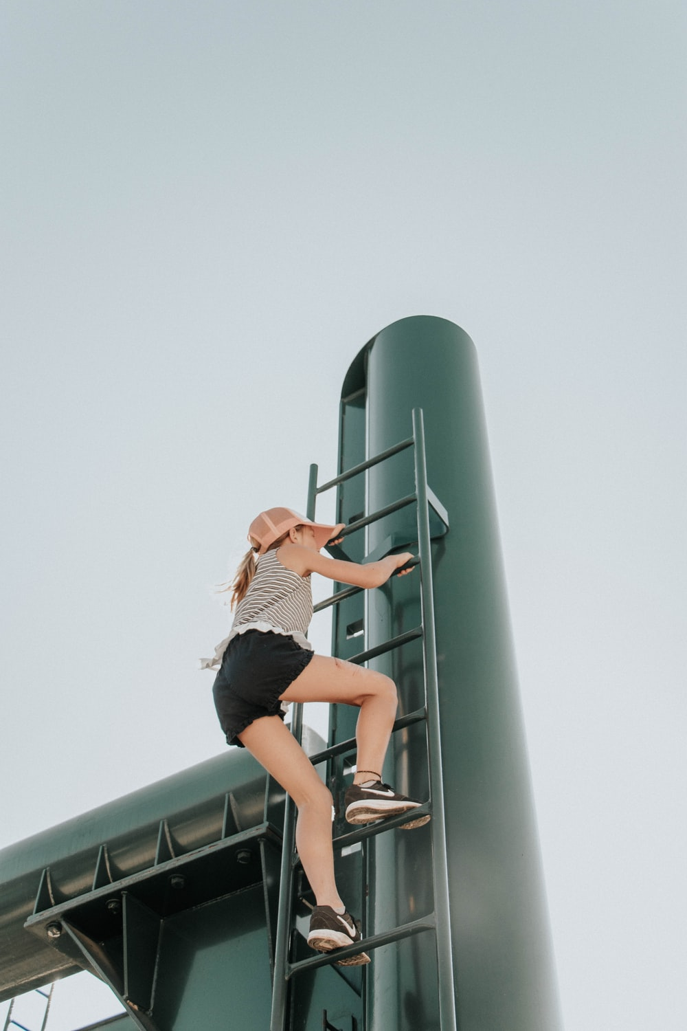 woman climbing ladder