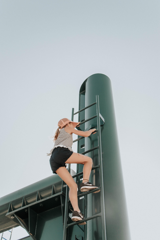 woman climbing ladder