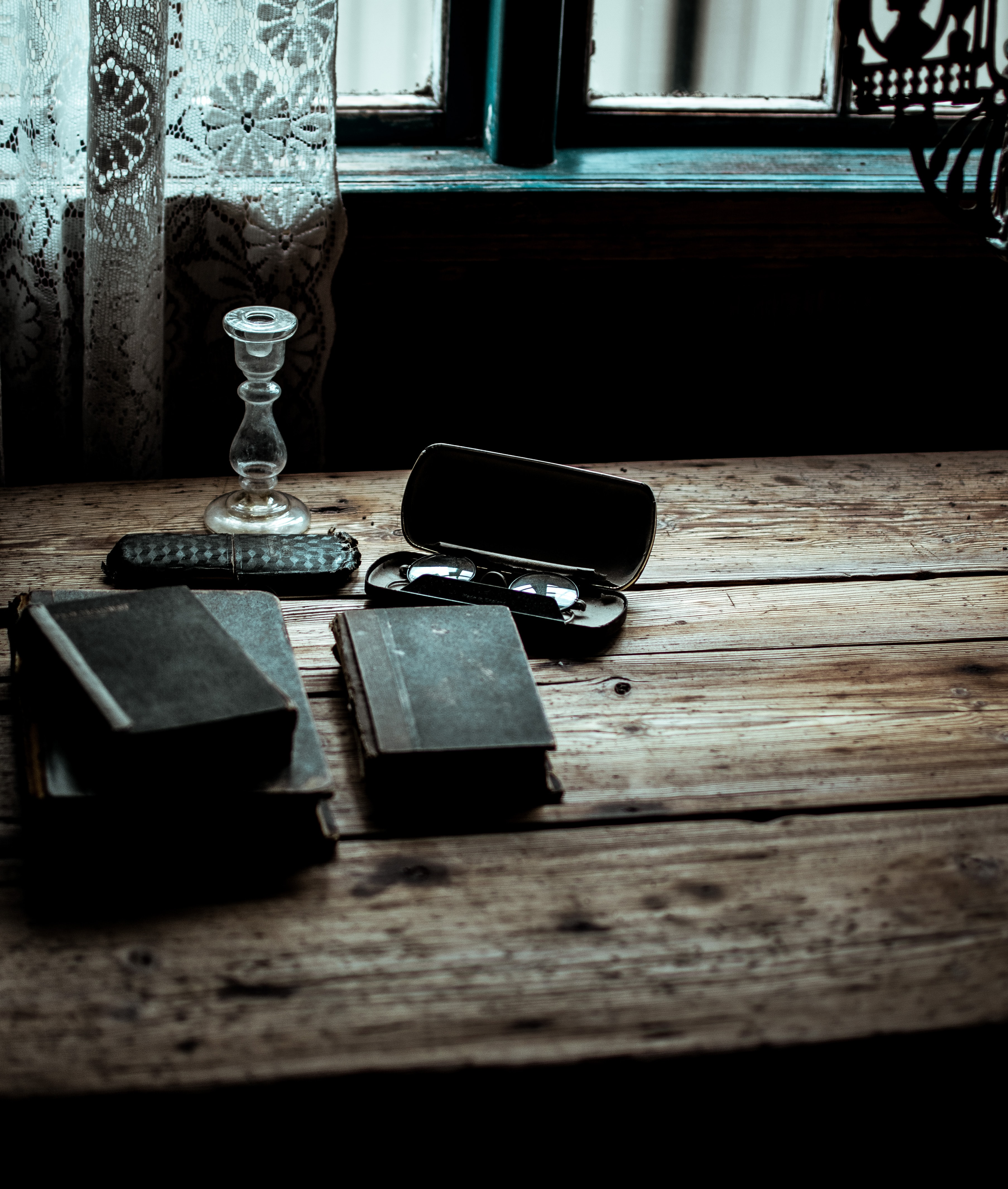 black covered book on wooden table