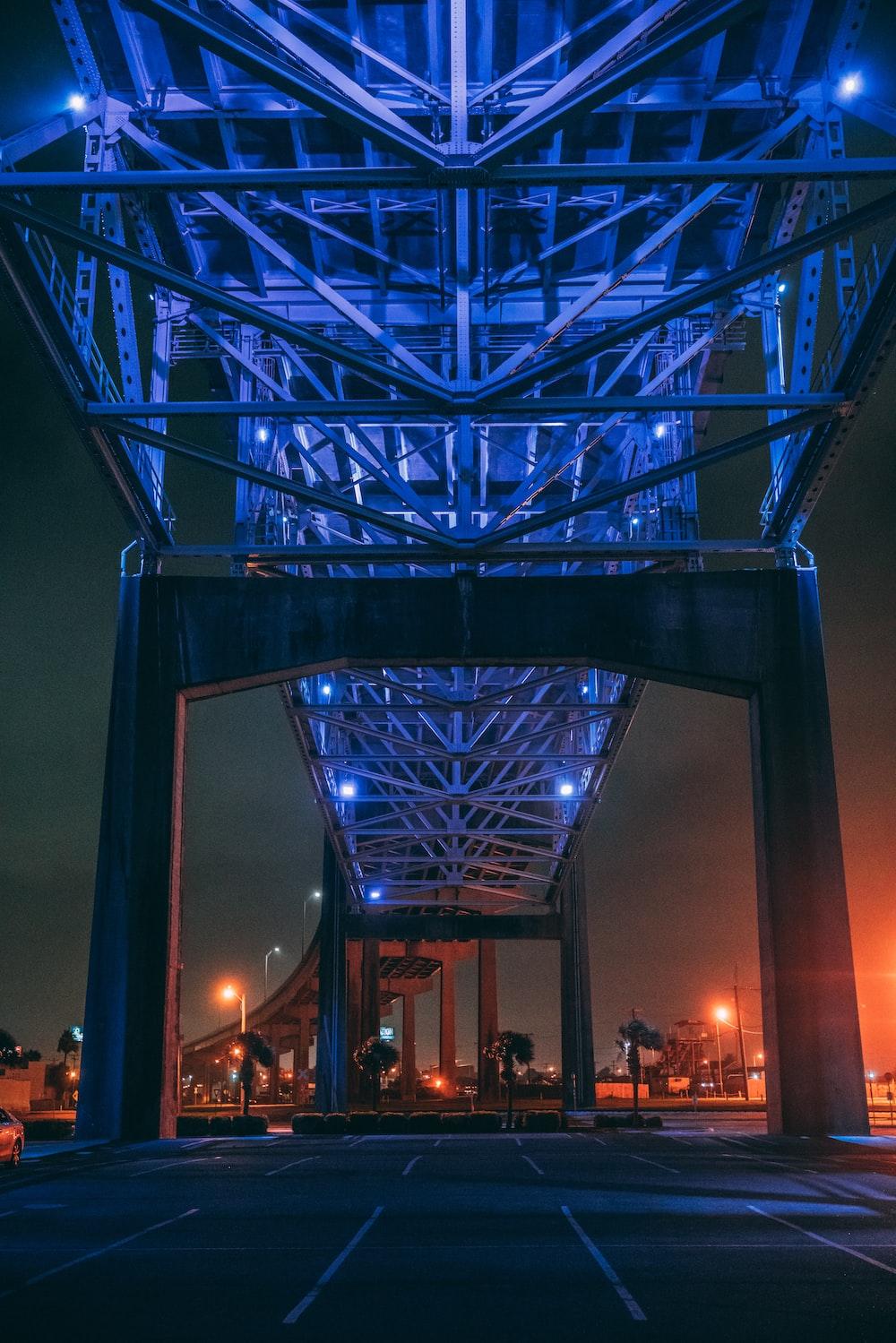 lighted gray metal bridge