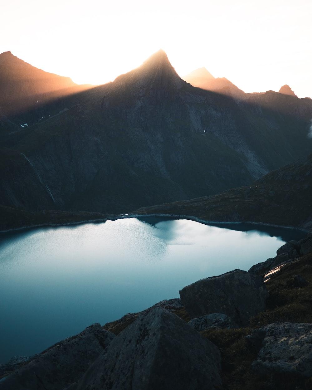 gray mountain near lake