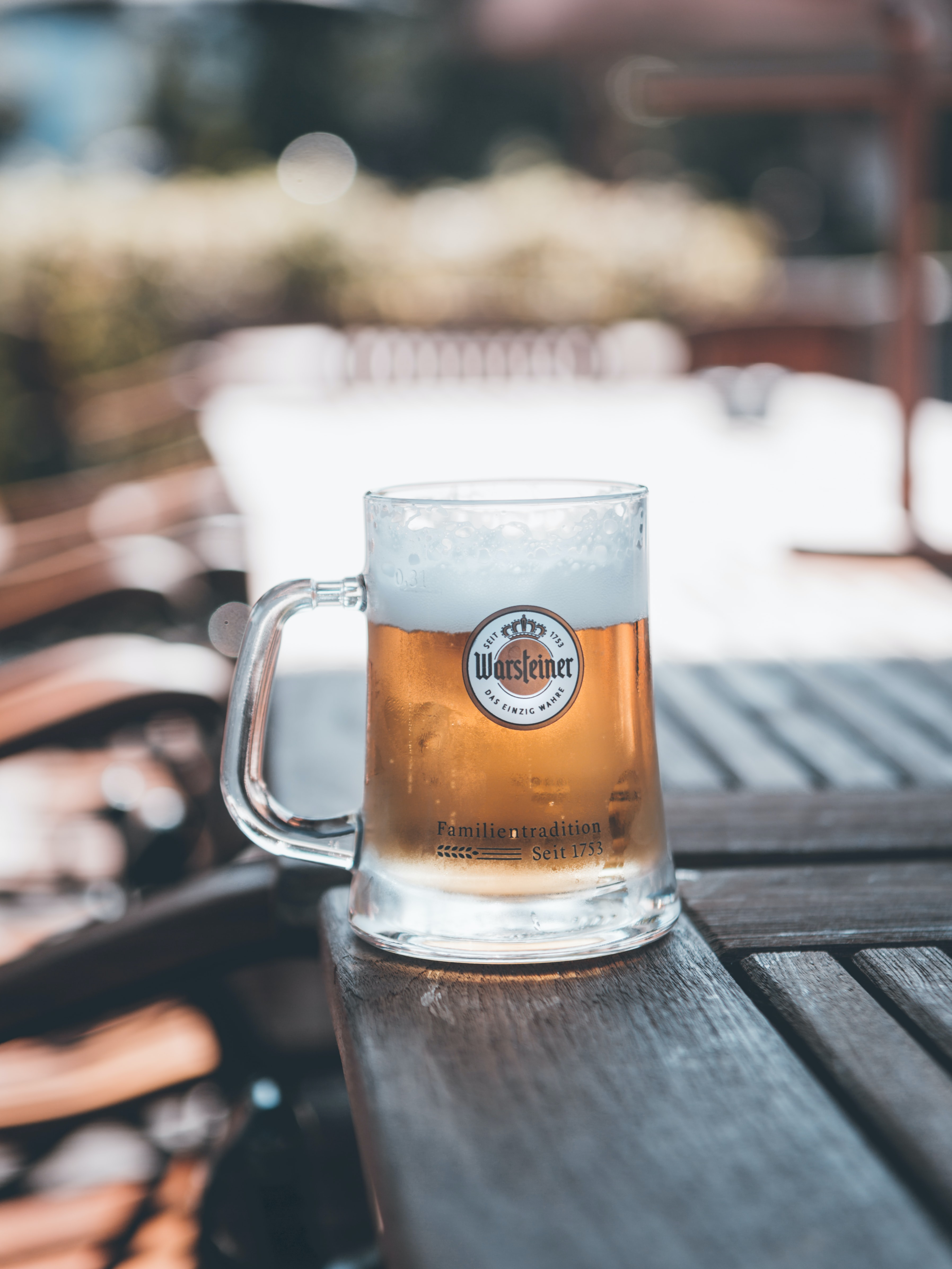 clear Warsteiner glass mug