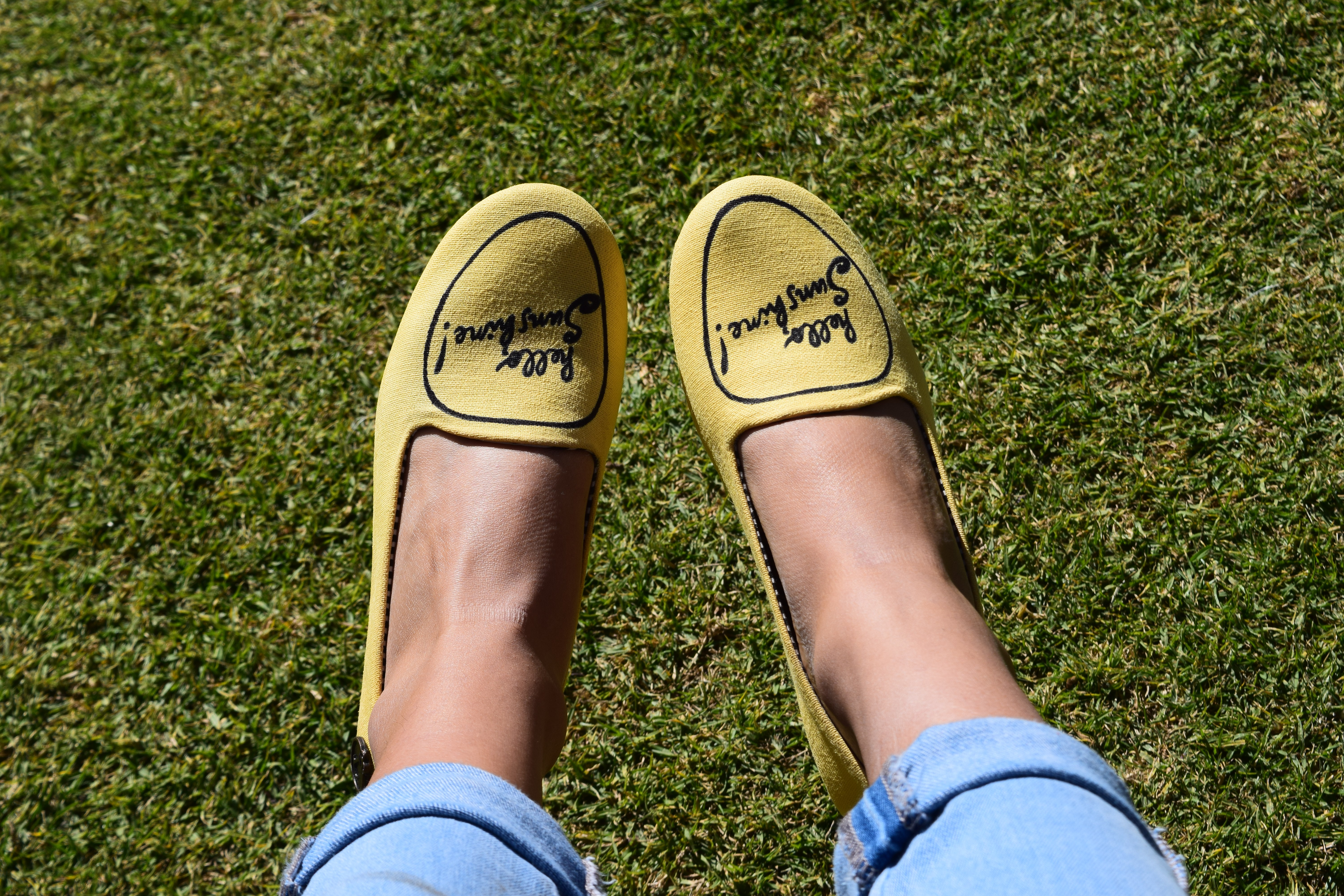 person wearing yellow slip-on shoes