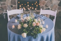 pink rose flowers arrangement on top of table