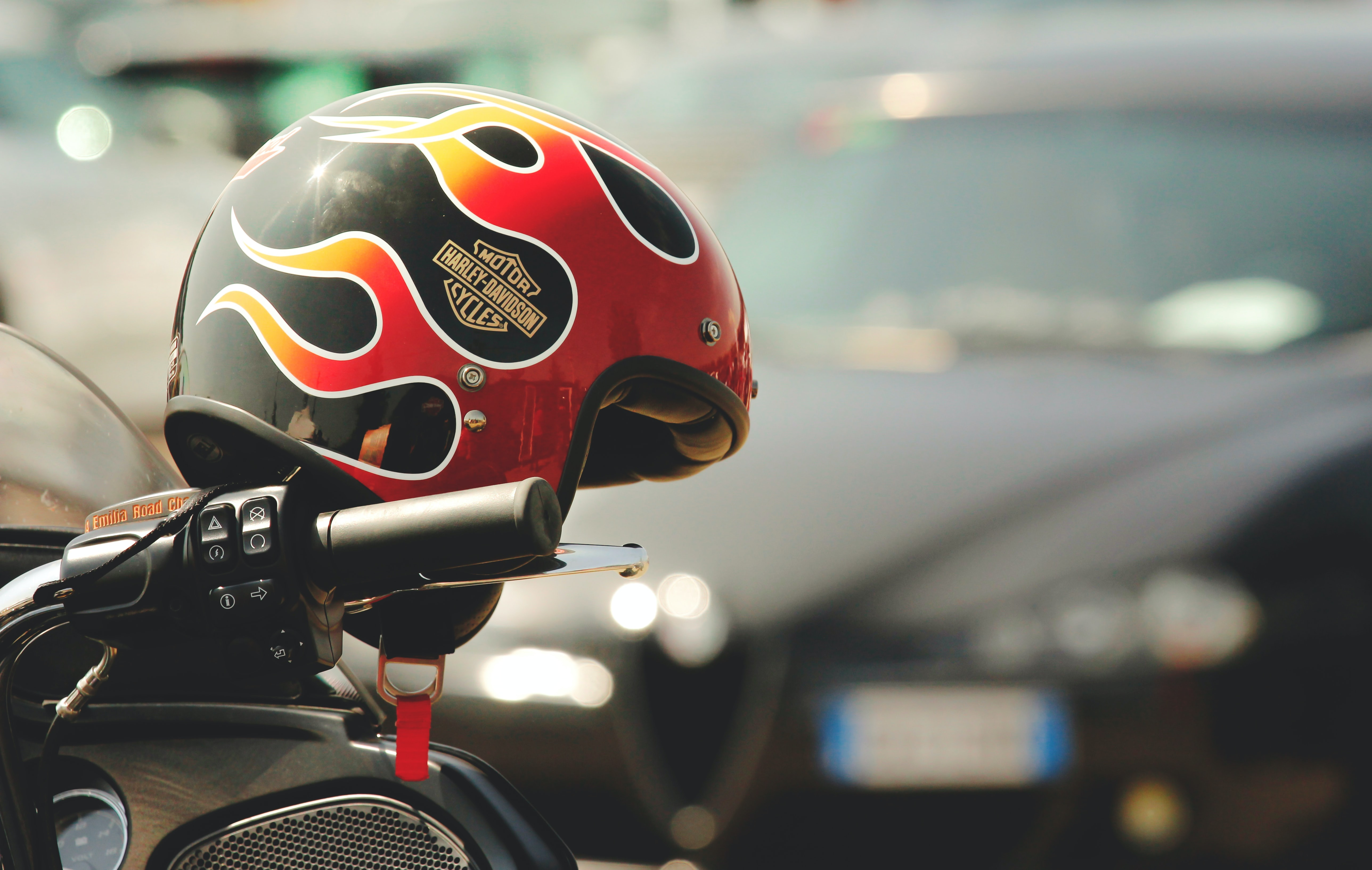 selective focus photograph of red and black Harley-Davidson helmet