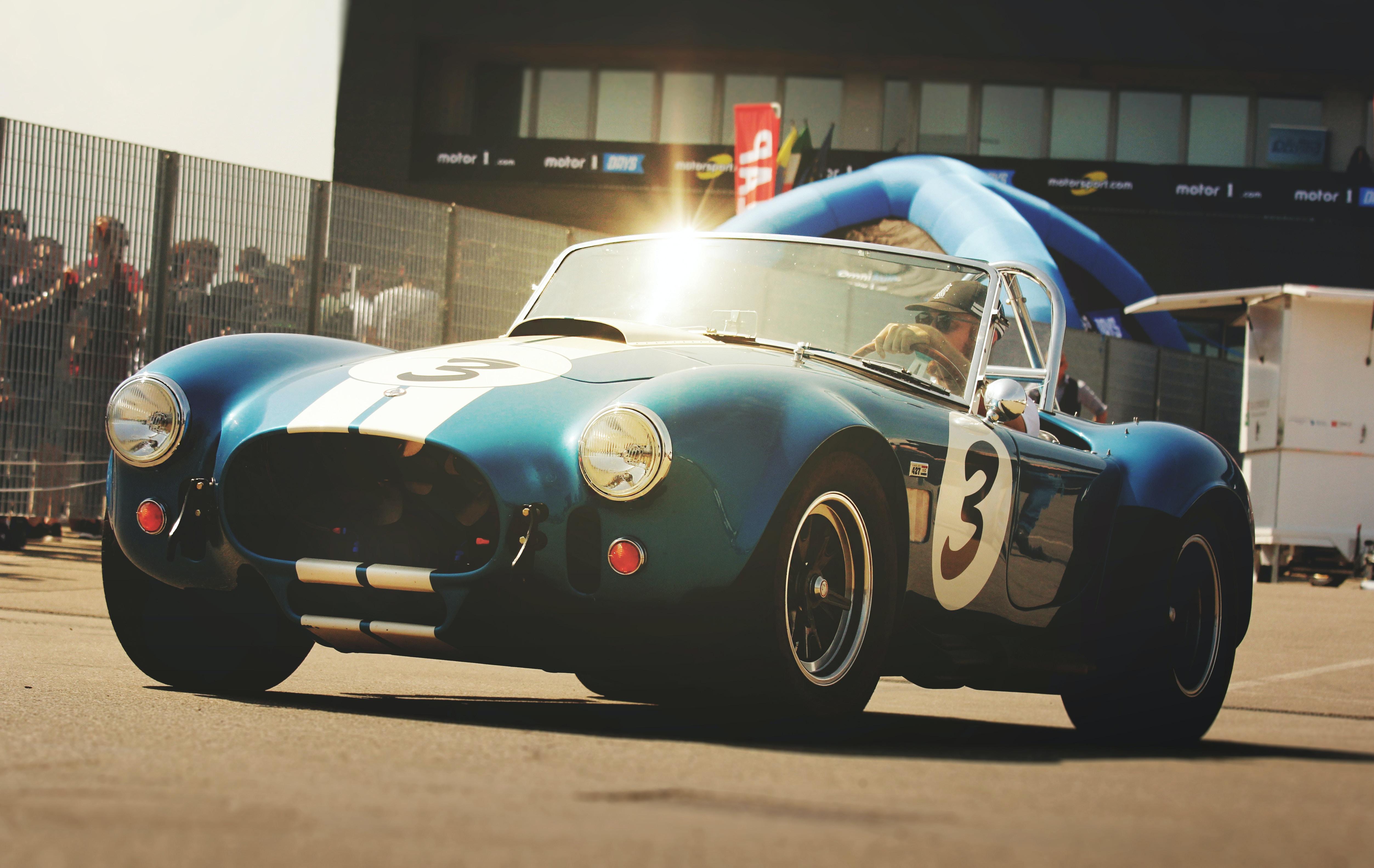 person driving blue race car