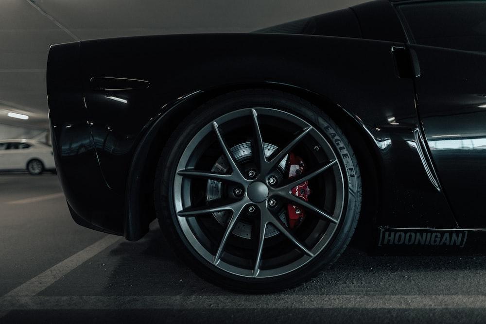 black 5-spoke vehicle wheel