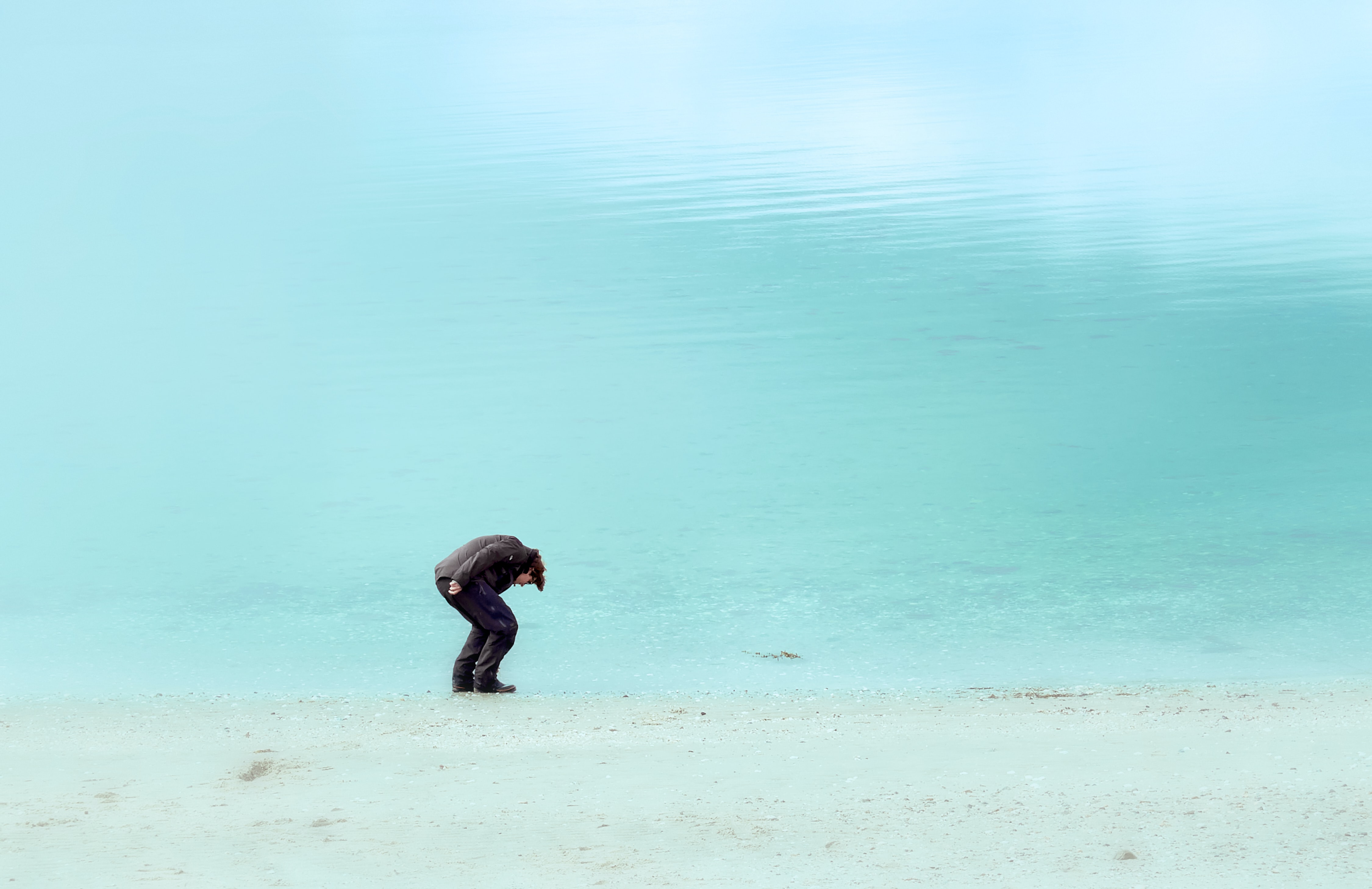 man standing on shore