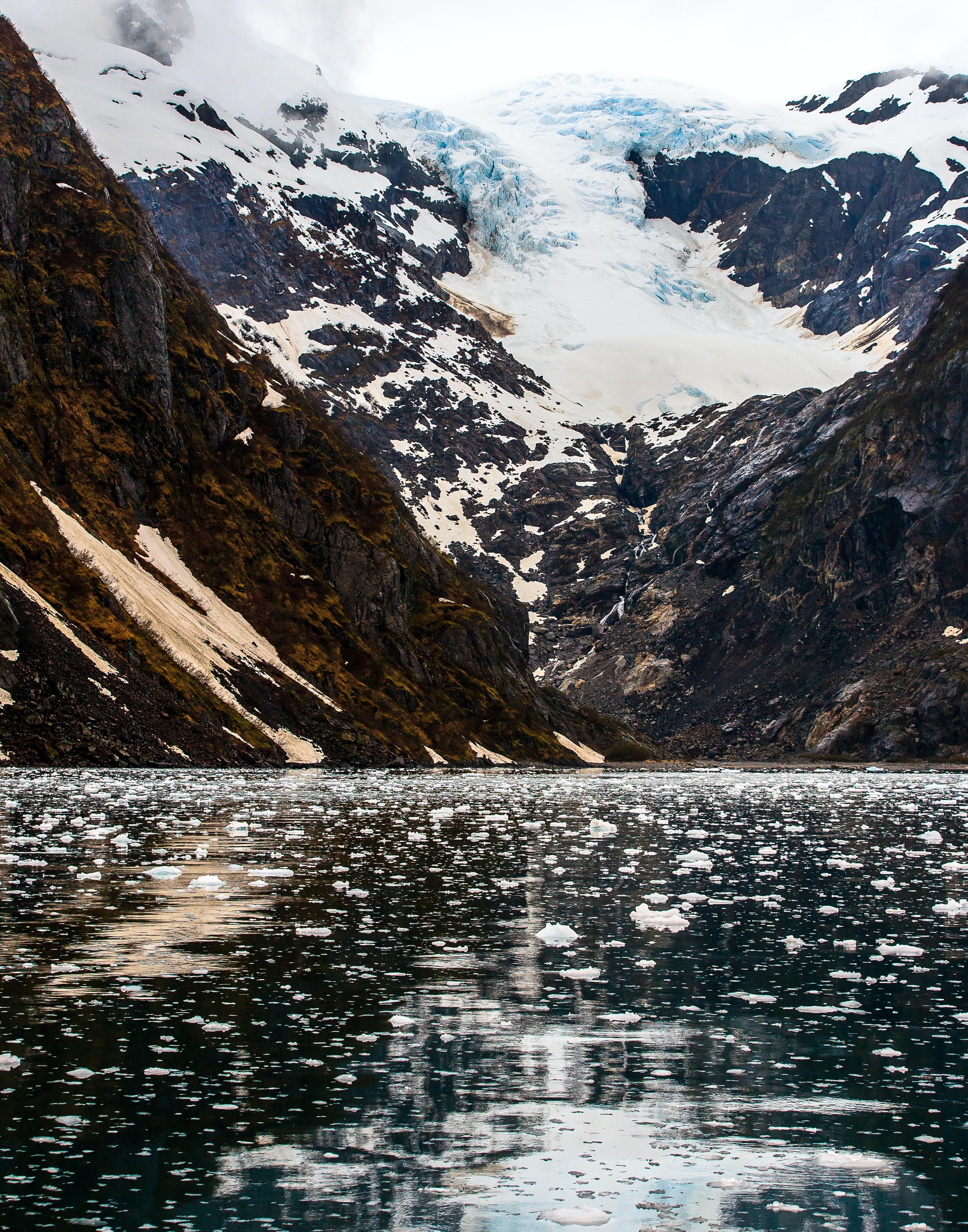 calm lake near glacier mountain at daytime
