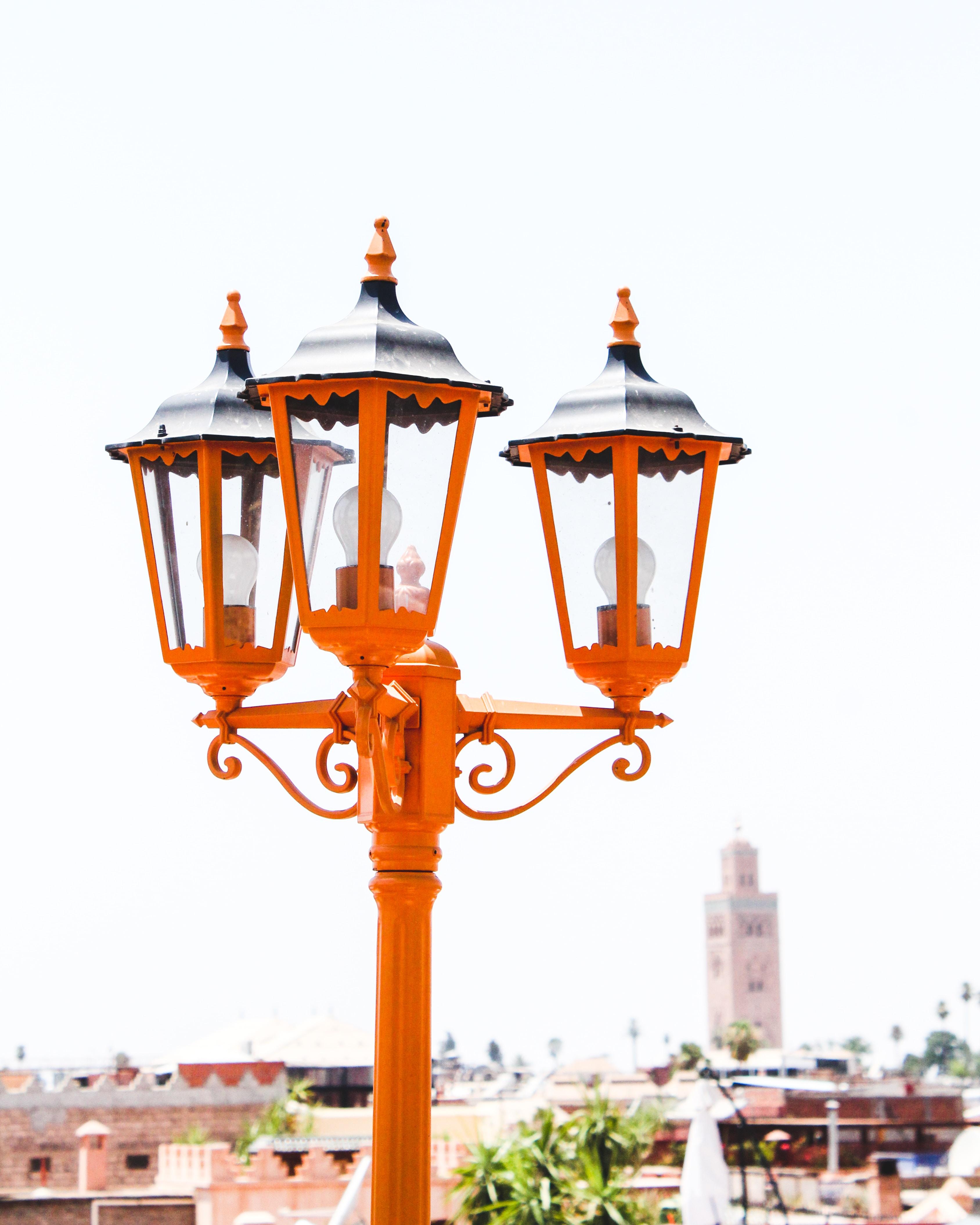 orange street light under sunny sky