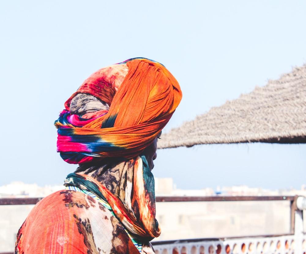 man wearing orange and pink turban