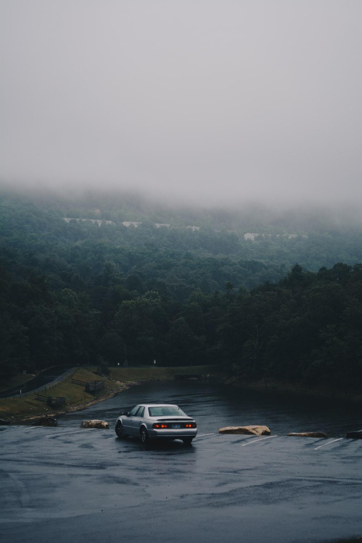 silver sedan on road