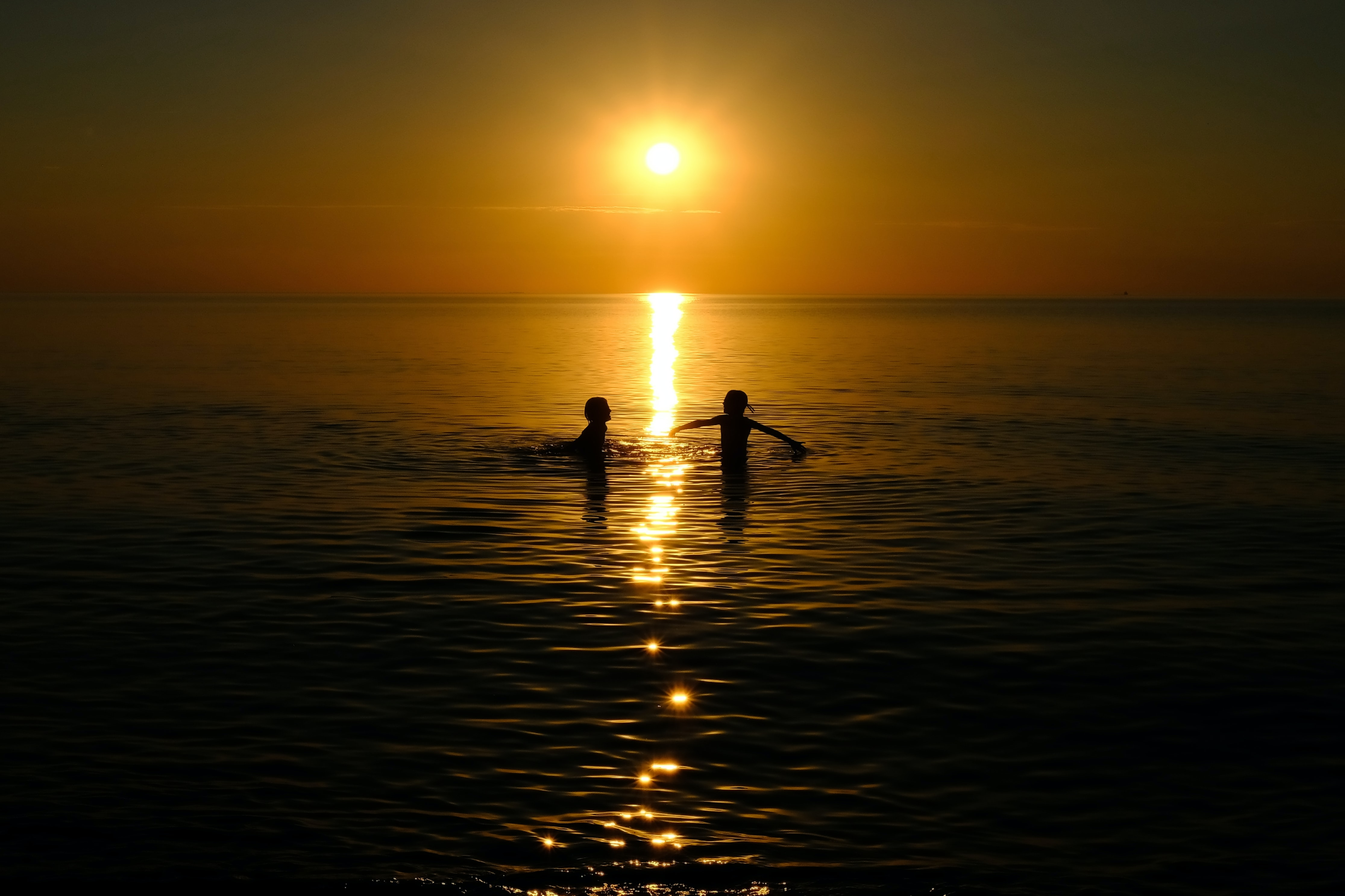 two children playing in the of the middle of the beach