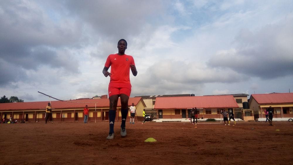 man wearing orange t-shirt