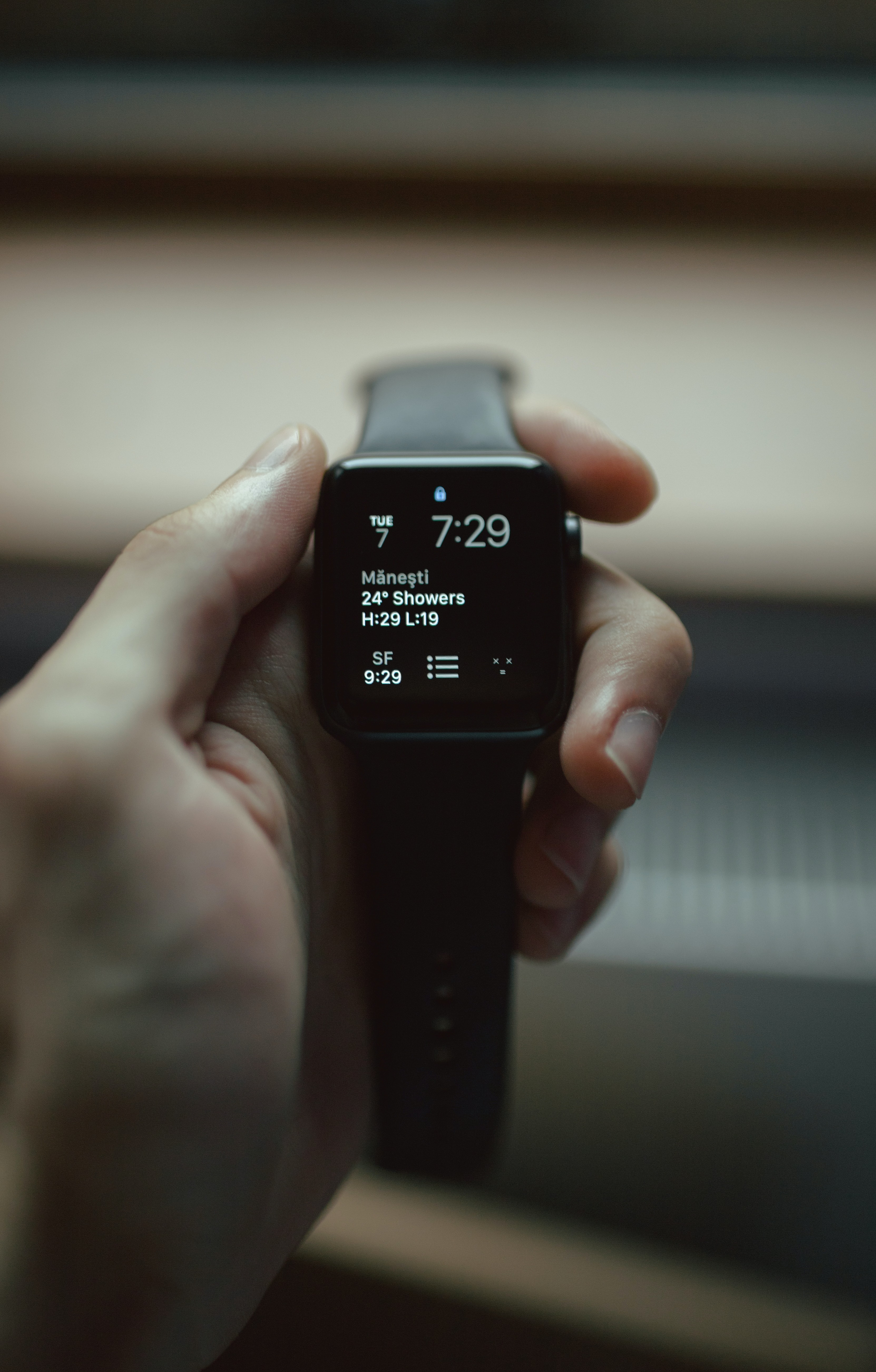 selective focus photography of space black aluminum case Apple Watch displaying 7:29