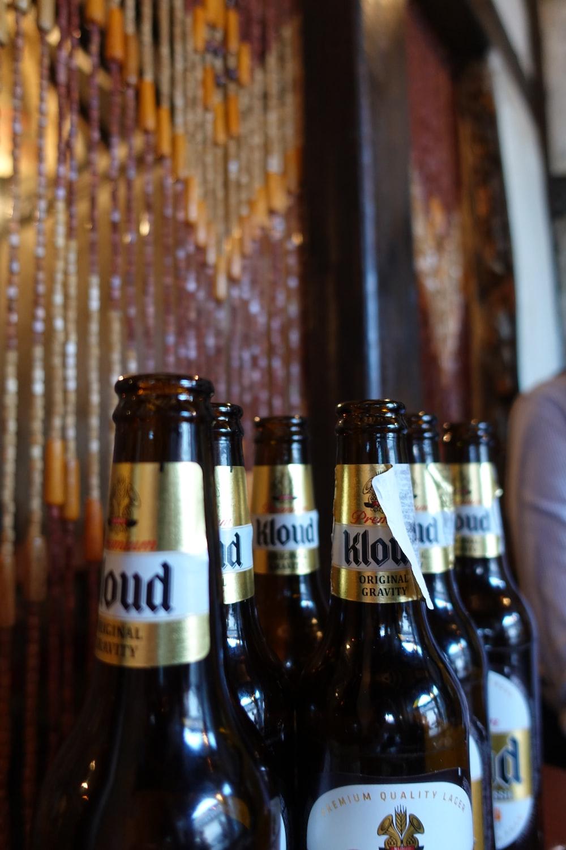 Kloud beer bottles near wall