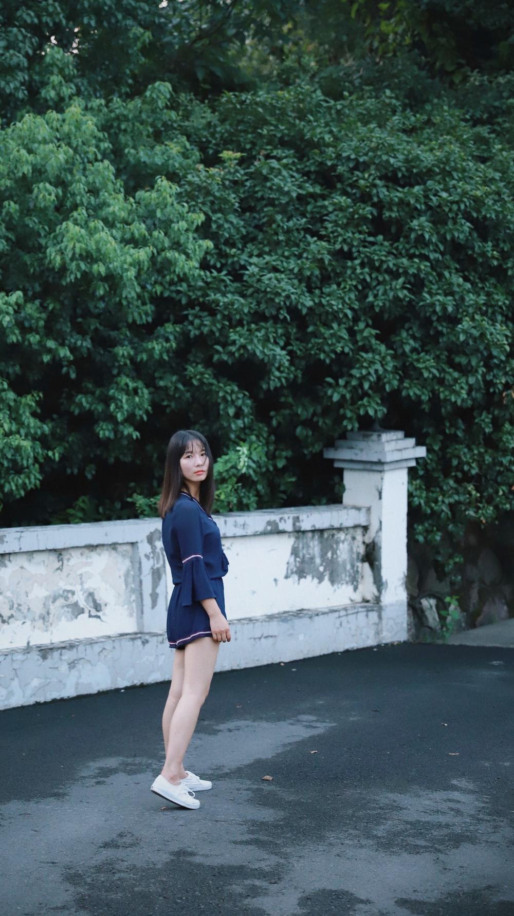 woman standing on concrete floor outdoor