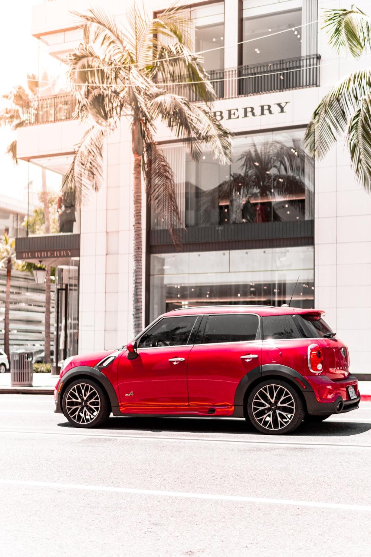 red 5-door hatchback in front of Burberry building