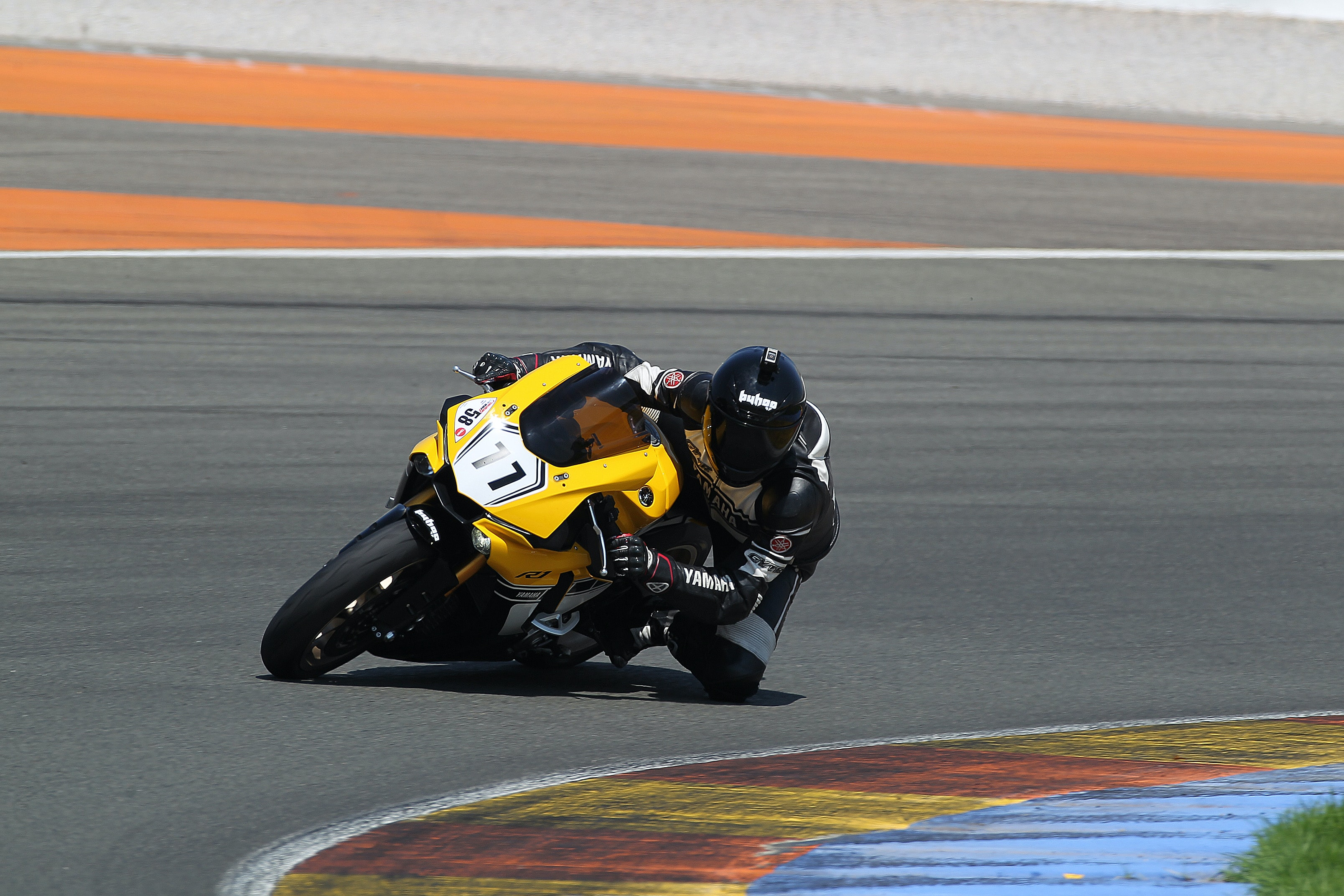 man riding yellow sportbike