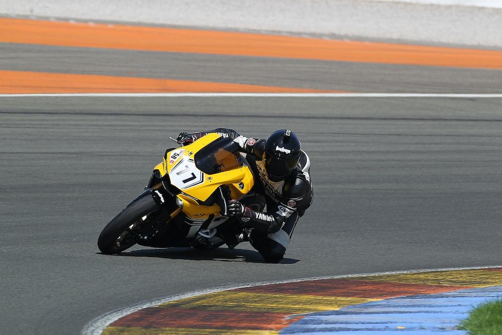 man riding yellow sportbike