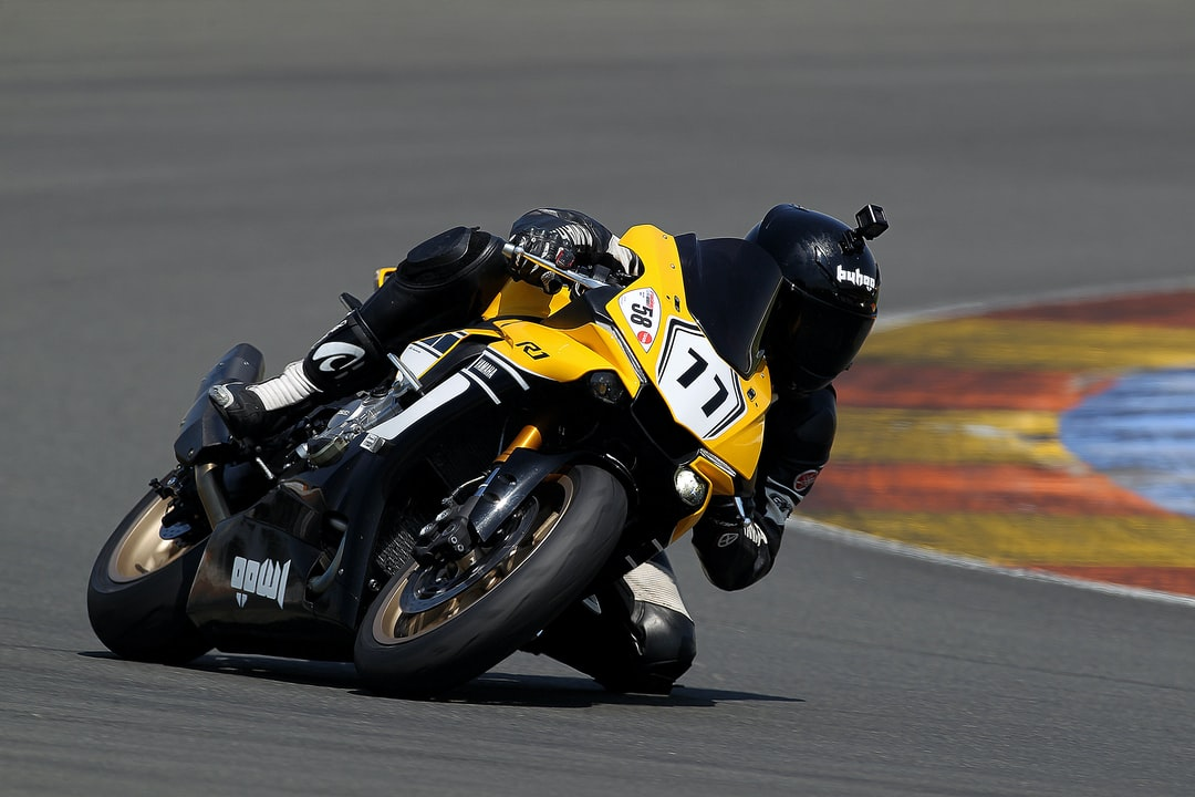 yellow and black sports motorcycle