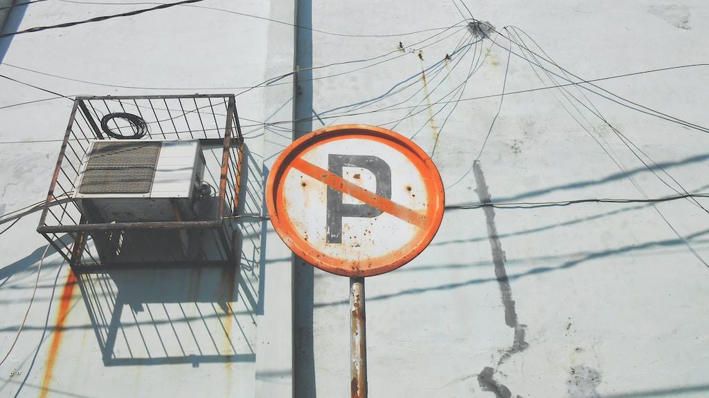 orange No parking road sign