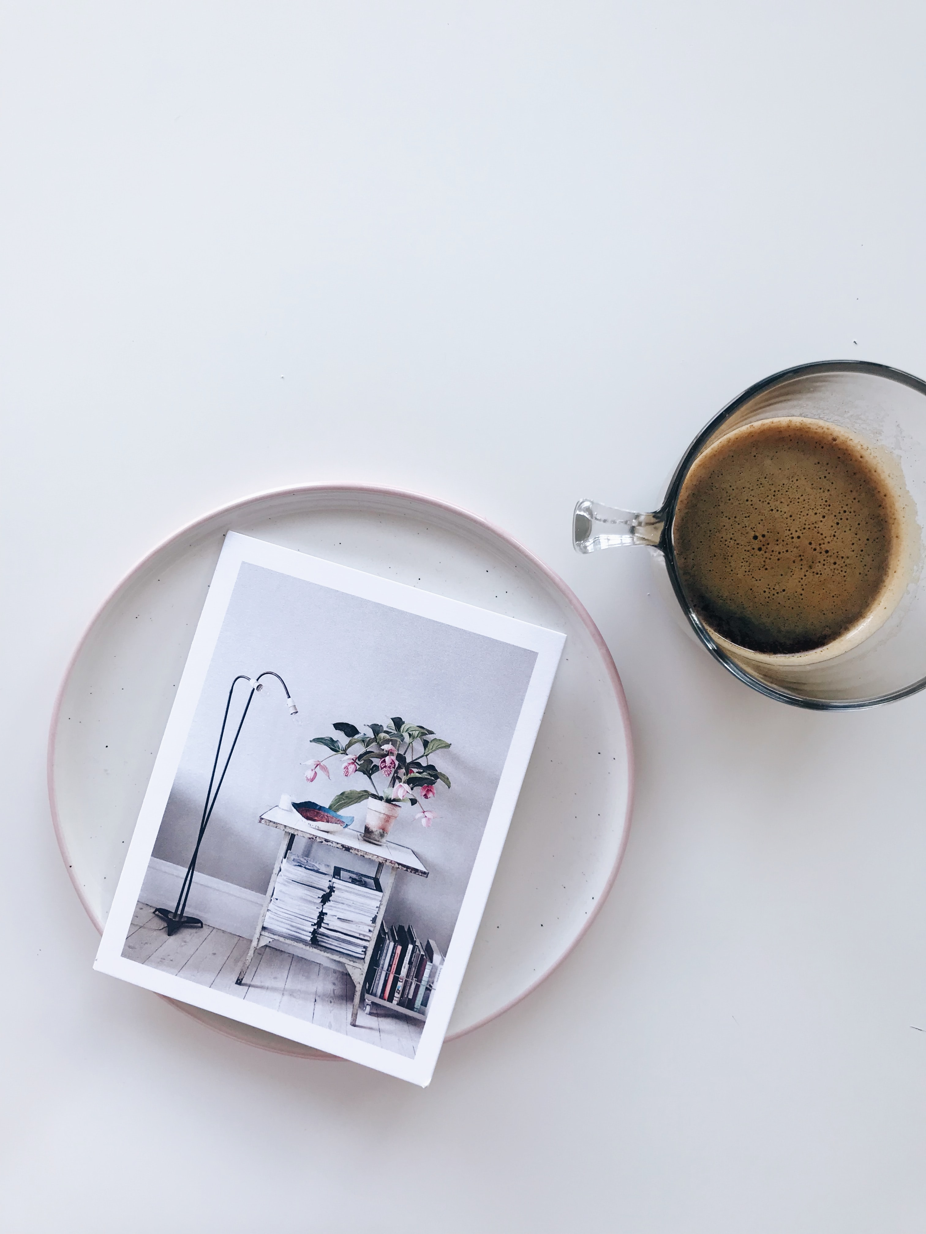 glass cup beside a photo on top of a tray