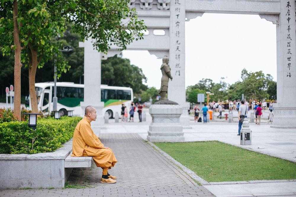 man sitting on bench