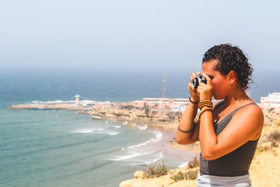 Agadir woman standing on high place taking photo