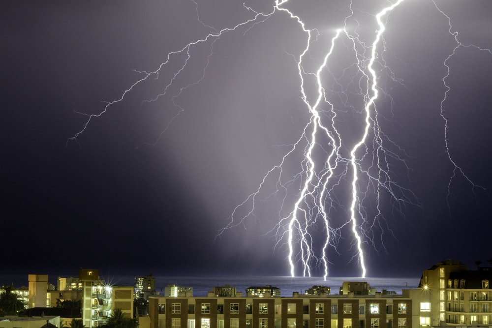 thunder on body of water near buildings