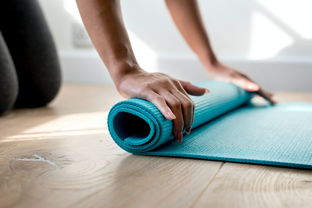 person holding teal mat