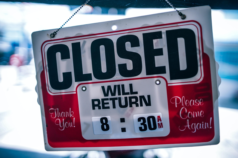 Closed Will Return 8:30 signage