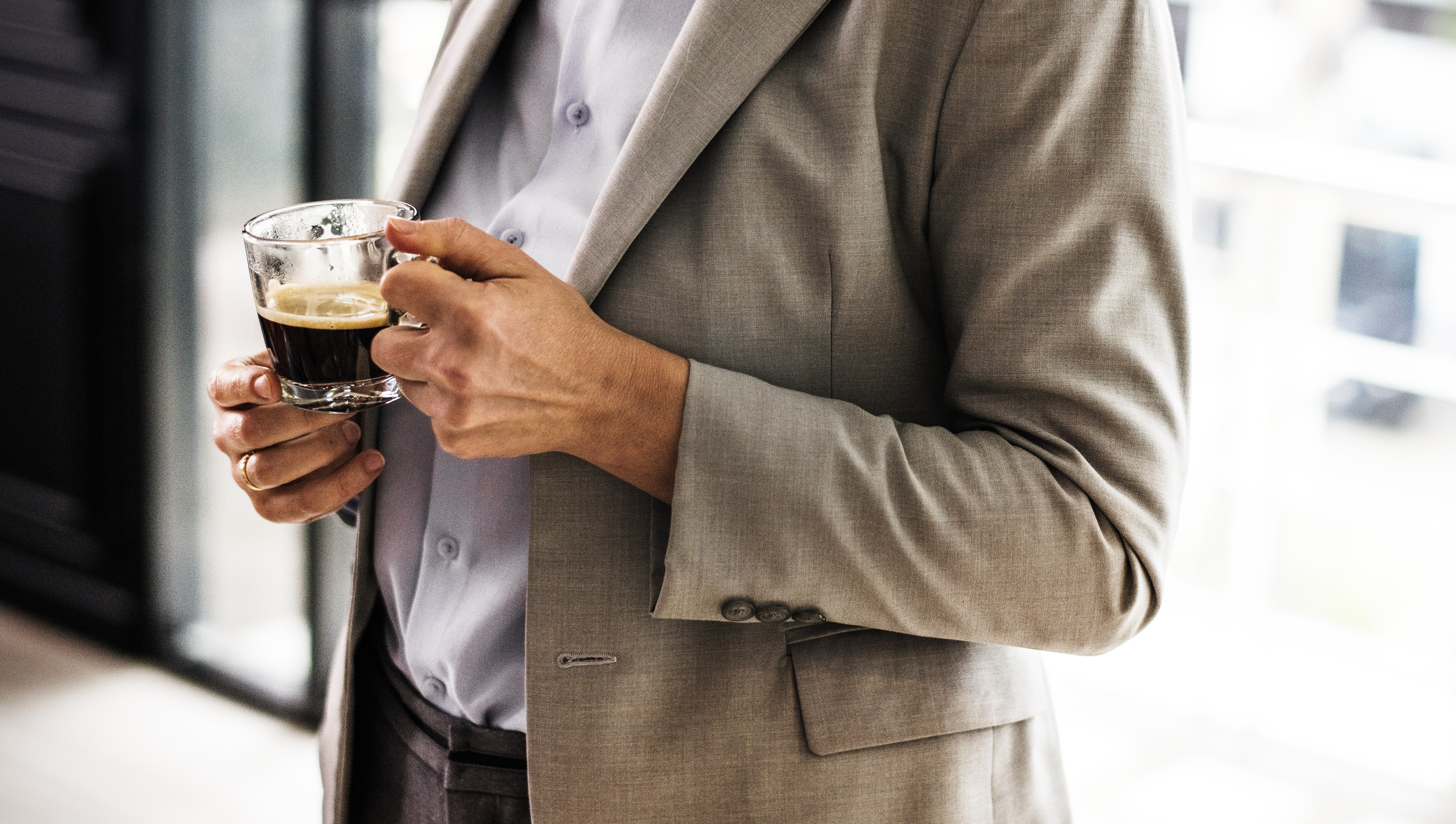 person holding half-filled cup