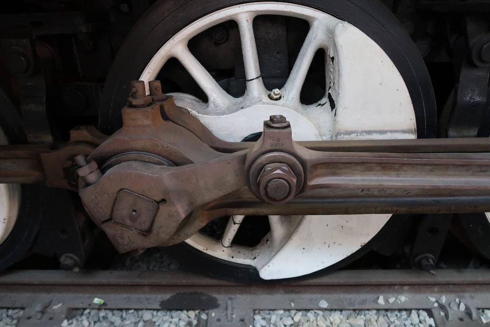 gray metal car wheel axle