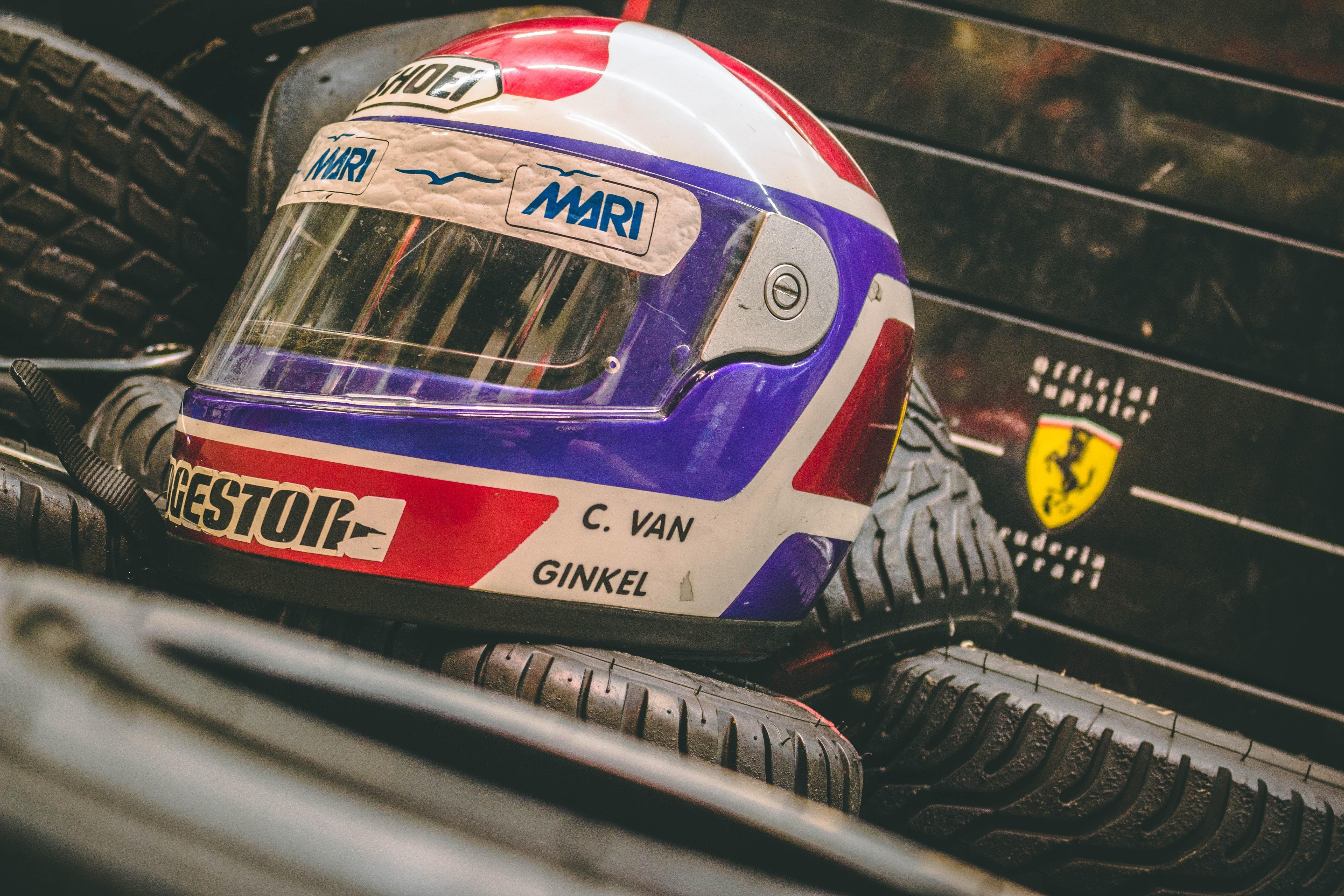 white and purple C. Van Ginkel helmet