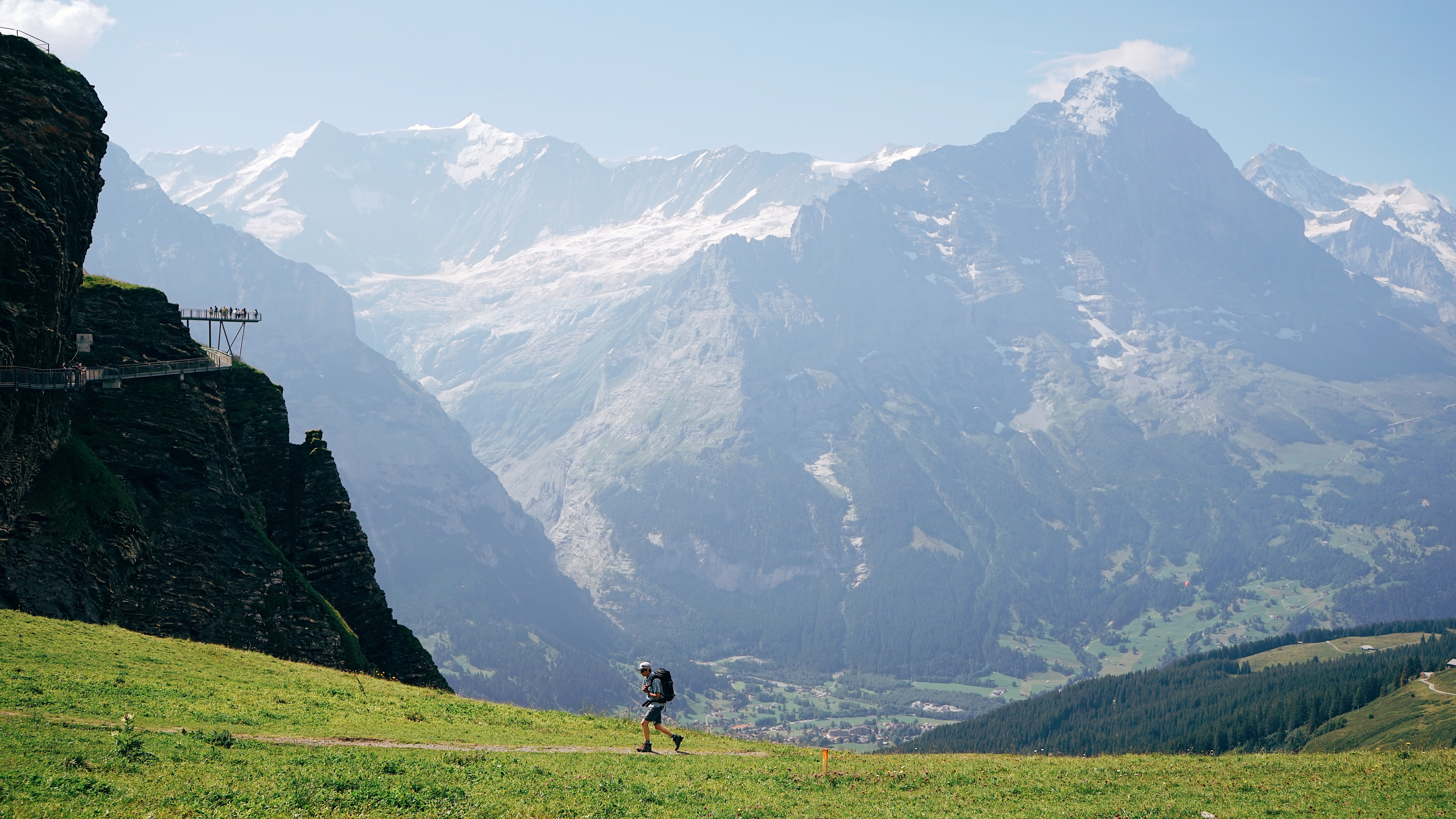 person hiking on mountain during daytime