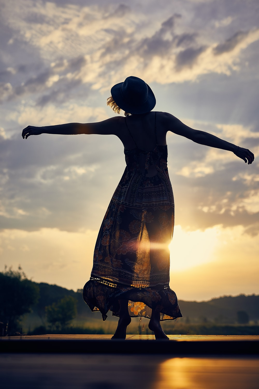silhouette of woman during sunset