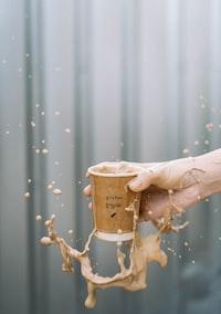 person holding Glinton cup