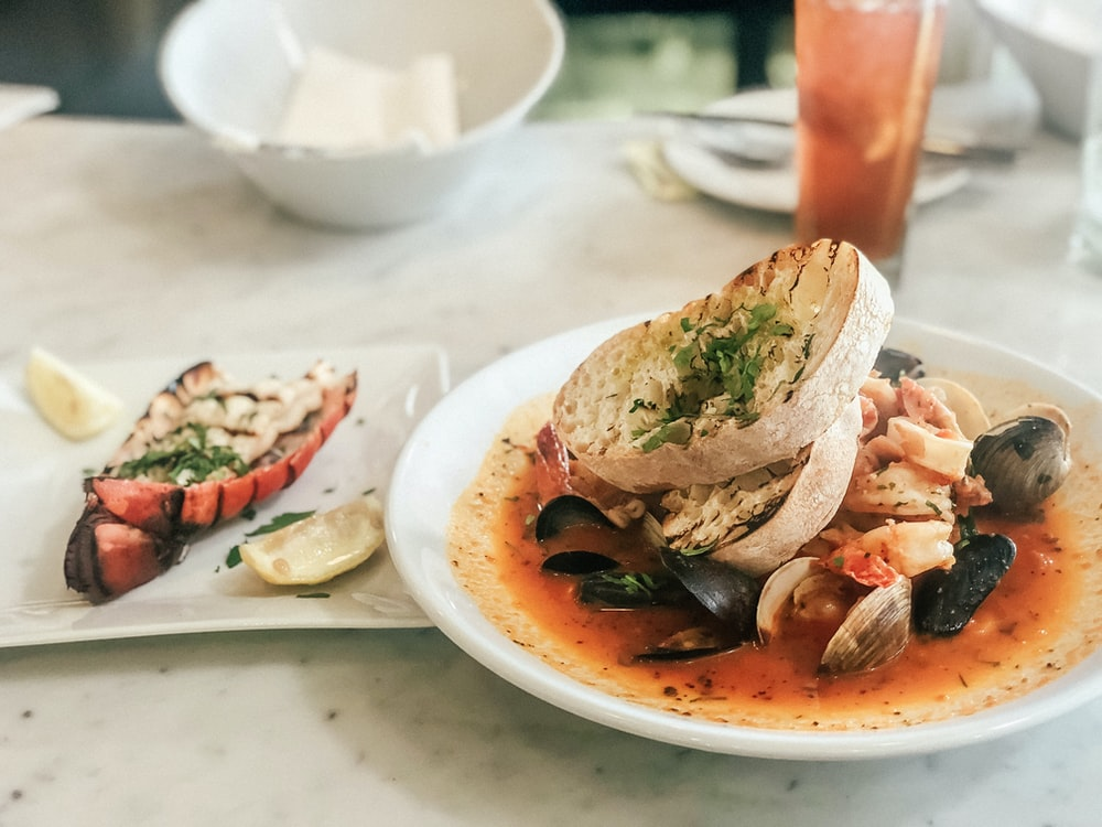toasted bread and clam shell dish
