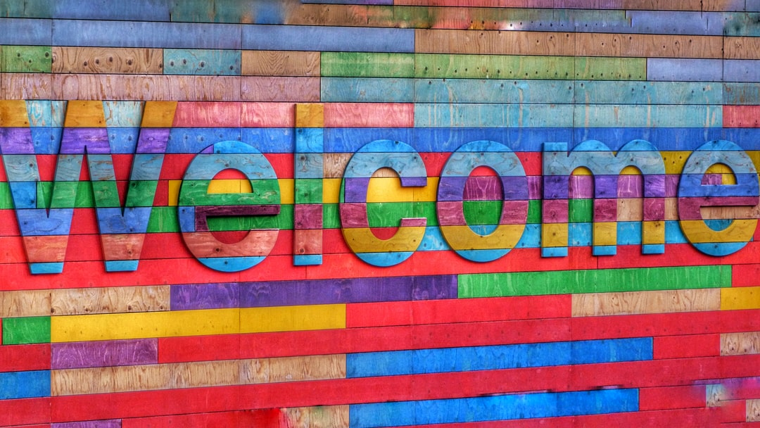 A colourful and welcoming sign that would make the majority of us feel welcome. Colourful and creative and an improvement on a plain wall.